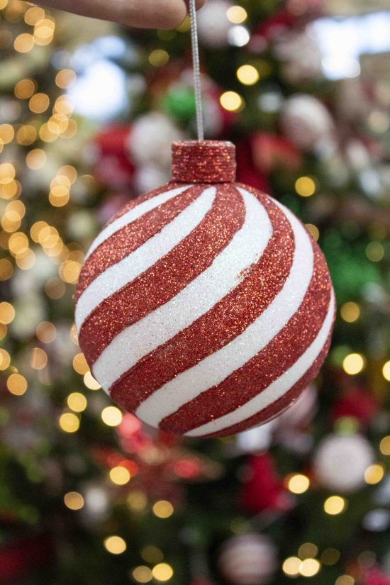 red and white swirled christmas ornament ball
